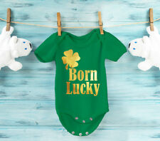 Baby's Born Lucky bodysuit baby grow vest with gold shamrock and text.