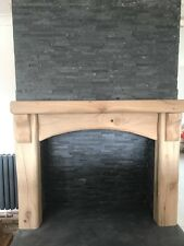 Traditional Rustic Oak Fireplace Surround with Arched Cross Board and Corbels