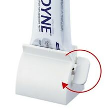 Rolling Toothpaste Tube Squeezer Cosmetic Seat Dispenser Holder Stand Bath Tool