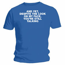 """And yet, despite the look on my face, you're still talking"" Funny Blue T-shirt"
