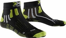 X-socks EFFEKTOR COURANT Shorts un noir / ACID GREEN Chaussettes de running