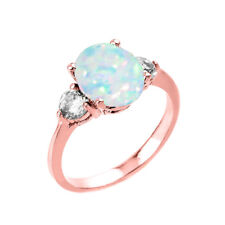 2.0 CTW Oval Lab Created Opal Three Stone Engagement Ring in Rose Gold