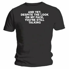 """And yet, despite the look on my face, you're still talking"" Funny Black T-shirt"