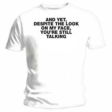 """Despite the look on my face, you're still talking"" Funny White T-shirt"