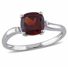 Sterling Silver Garnet and Round-cut Diamond Accent Ring