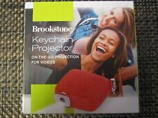 Brookstone Keychain Projector BRAND NEW IN BOX RED