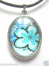 White hibiscus design resin cabochon oval pendant surf style black cord necklace