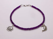 Purple Crackle Glass Bracelet with sun and moon charms