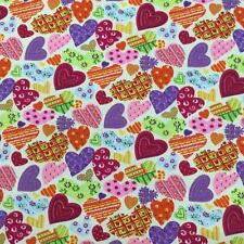 "Printed poly cotton Turquoise with Multi Hearts 115cm 45"" wide sold by metre"