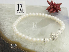 Freshwater Cultured Pearls Bracelet with Crystal beads & a Rhinestone Clasp.