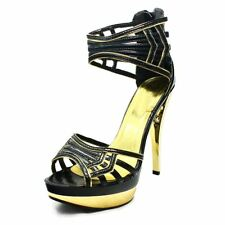Stunning High heel Black / Gold ankle cuff shoes
