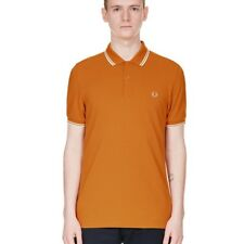 Polo Mostaza Pique Vivos Blancos de Fred Perry Clothes
