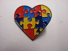 Heart shaped Autism awareness Pin badge. Jigsaw puzzle design. Autistic Bigger