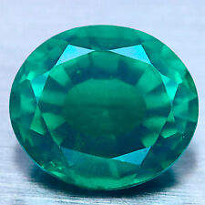 9.31 CT GREEN CREATED EMERALD DOUBLET WITH WHITE QUARTZ OVAL