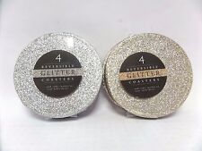 A SET OF 4 REVERSIBLE GLITTER COASTERS SILVER & GOLD