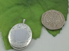 Sassi SL1015 Ladies Medium Size 925 Sterling Silver Edge Engraved Oval Locket