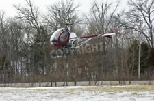 "Bildmotiv ""Helicopter landing in field with snow """