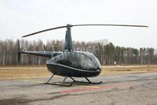 "Bildmotiv ""Aircraft - dark green small helicopter on the parking against the..."""