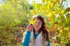 """Bildmotiv """"Autumn kid girl relaxed in fall forest with leaves"""""""
