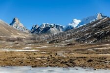 """Bildmotiv """"Mountains witn snow and below with tourists on the ground with br..."""""""