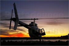 Poster / Leinwandbild Heliview Helicopter at Dawn - David Wall