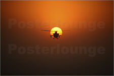 Poster / Leinwandbild An AH-64D Apache helicopter flying into th... - T. Moore
