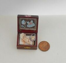 Miniature porcelain doll in a wooden trunk   Doll house Toy