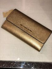 MICHAEL KORS JET SET TRAVEL SAFFIANO LEATHER LARGE TRIFOLD WALLET IN GOLD