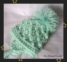 Babys unisex Mint Green Crocheted Pom Pom Hat sizes from Newborn to 12-24 Months