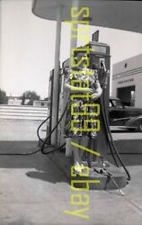 1950s Lady Standing By Gas Station Pumps - Vintage Bandw Negative