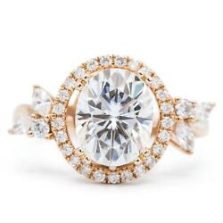 10x8mm Oval Moissanite 14k Rose Gold Halo With Side Diamonds Ring