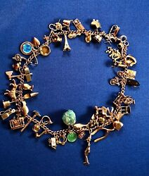 Vintage 14K Gold Charm Bracelet double wrapped with 54 (some rare) charms