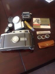 1950's Poloroid Land 800 Camera With Leather Case and all accessories.