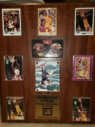 Shaquille o'neal rookie cards in wooden plaque. All cards are in mint condition.
