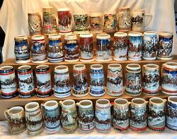 Lot Of 38 Budweiser Clydesdale's Holiday Beer Stein Christmas Mugs 1980-2008