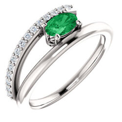 Emerald And 1/8 Ctw Diamond Bypass Ring In Platinum
