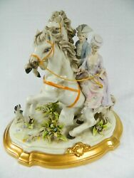 Signed Capodimonte Statue With Man And Woman Riding Horses