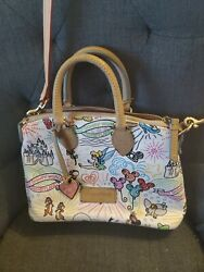 Dooney and Bourke Sketch Disney small crossbody and wristlet $170.00