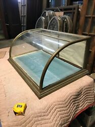 An Antique Curved Glass Nickel Table Top Showcase 38.5 X 24