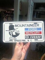 1980s Mountaineer Ford Mercury Dealership Booster License Plate Spruce Pine Nc