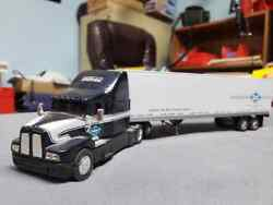 Ertl Midwest Specialized Kenworth And Van Trailer. 1/64th Scale.