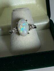 3.00ct Oval Australian Opal And 0.30ct Diamond Ring In 18k White Gold