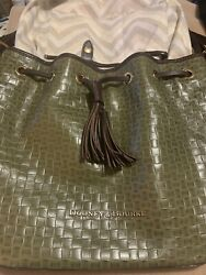 Dooney And Bourke Army Green With Brown Leather Adjustable Strap Duffle Purse