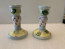 Hand Painted, Multi-colored Ceramic Candle Sticks .