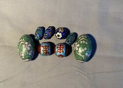 Group Of Eight Chinese Enamel Silver Beads.