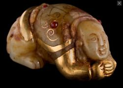 An Unusual Chinese Gold Mounted Jade Crouching Hotei With Red Cabochons Stones