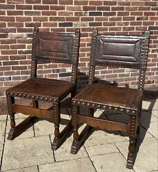 Pair Of 1920s Spanish Revival Leather Upholstered Large Rivet Sled Base Chairs