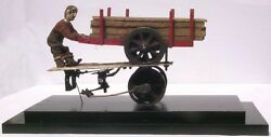 Man On Wood Wagon From An Extraordinary Collection Of Hand Carved Figures.