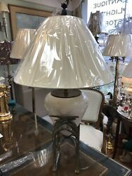 Antique Beige Ceramic Table Lamp Nestled In A Bronze Stand