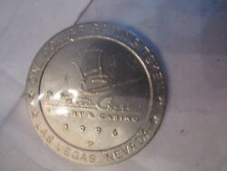 9 Vintage Metal Casino Gaming Chips - One Dollar - Caesars, Monte Carlo And More